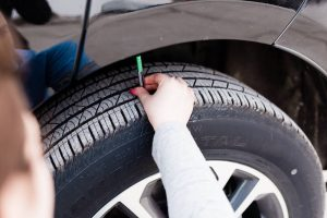 Use a tire gauge to find your tread depth